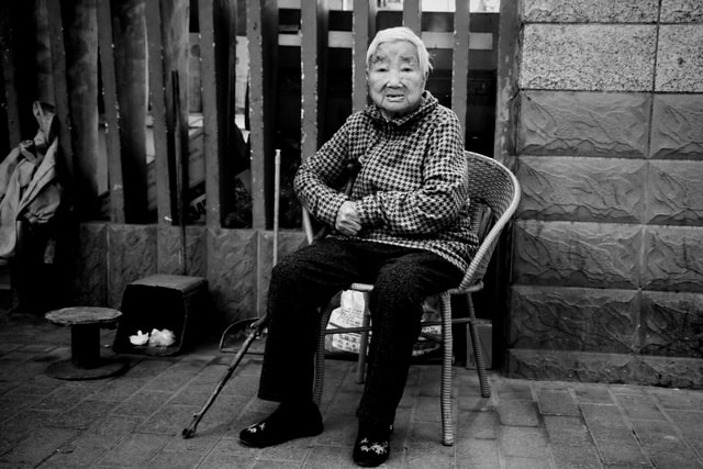 man-sitting-street-monochrome-people picture material