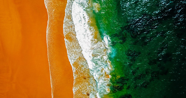 aerial-panoramic-drone-view-of-blue-ocean-waves-beautiful-sandy-beach-in-portugal picture material