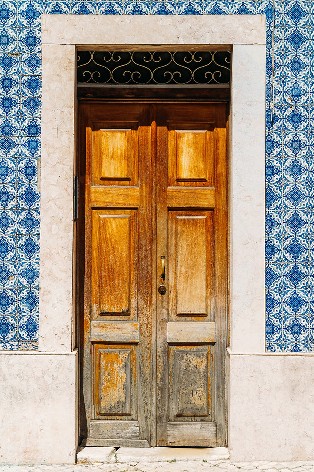 vintage-wooden-door-with-blue-marble-tiles-wall-in-lisbon-portugal picture material