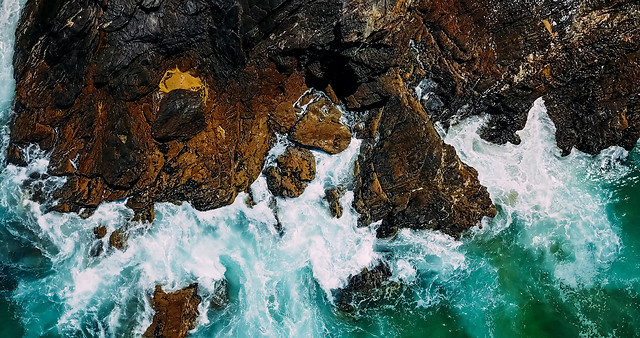 aerial-drone-view-of-dramatic-ocean-waves-crushing-on-rocky-landscape picture material