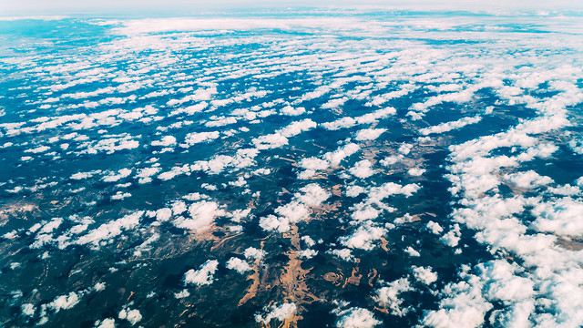 flying-through-beautiful-landscape-of-earth-clouds picture material