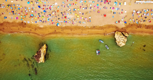 aerial-summer-top-view-from-flying-drone-of-people-crowd-having-fun-on-beach-in-portugal picture material