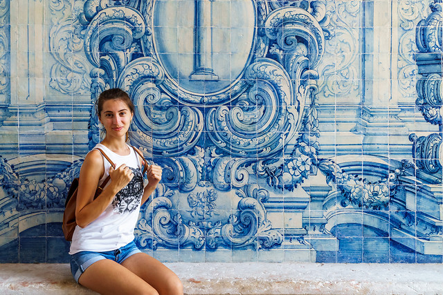 young-tourist-woman-posing-near-portuguese-azulejos-wall-in-lisbon picture material