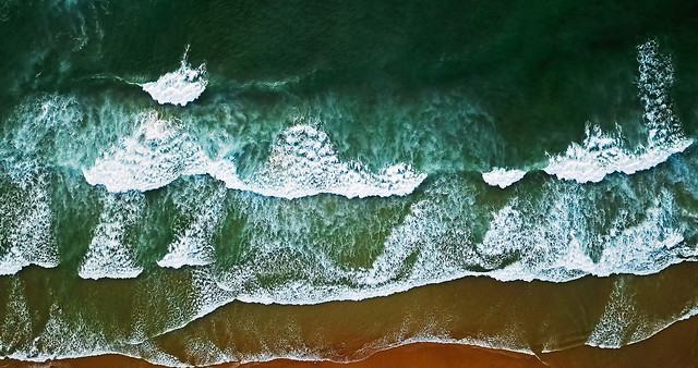 aerial-view-from-flying-drone-of-ocean-waves-beautiful-beach-in-algarve-portugal picture material