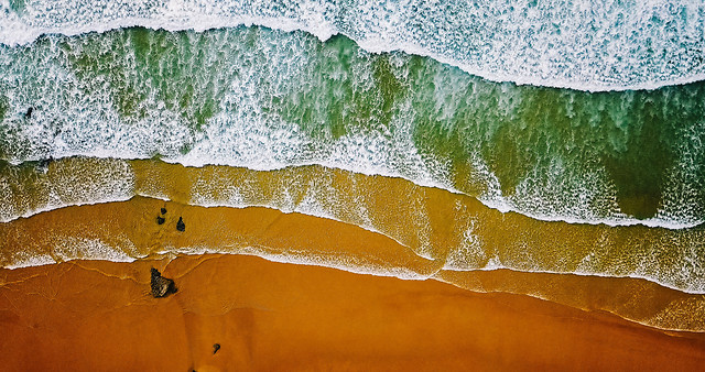 aerial-view-from-flying-drone-of-ocean-waves-crushing-on-beach picture material