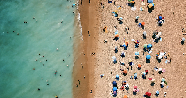 aerial-view-from-flying-drone-of-people-crowd-relaxing-on-beach-in-portugal picture material