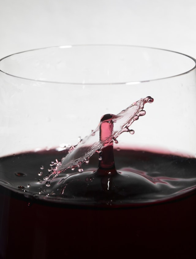 wine-drops-collide-inside-glass picture material