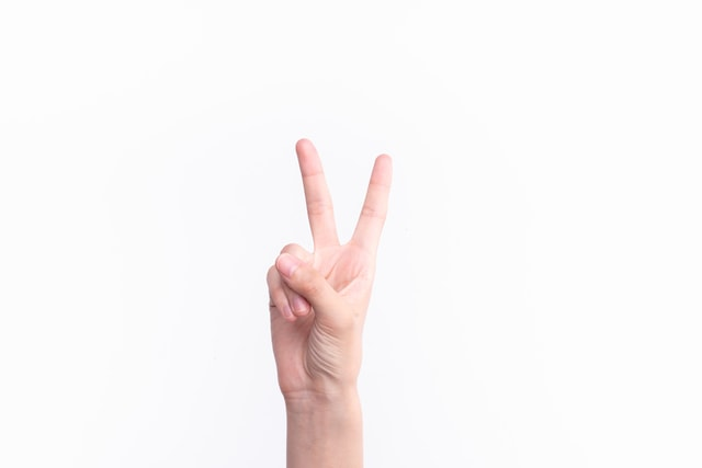 the-gesture-representing-the-number-two picture material