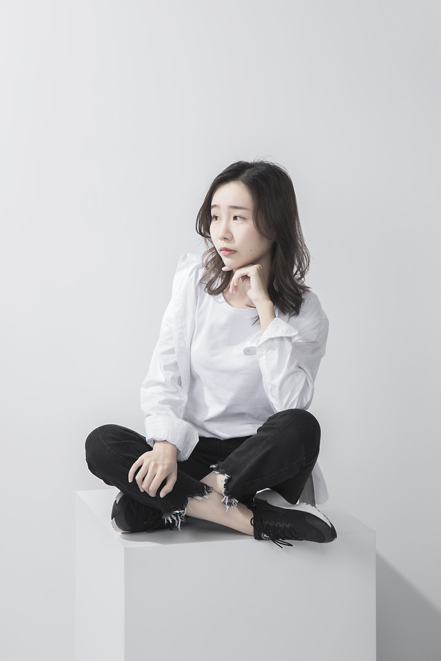 woman-white-black-sitting-fashion picture material