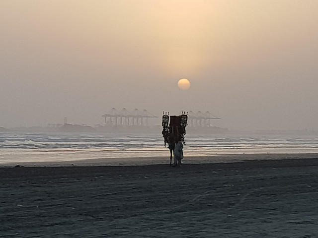 the-view-of-sunset-in-karachi-pakistan picture material