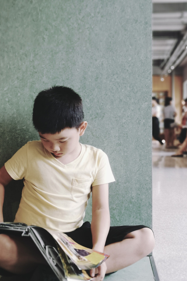 sitting-child-child-reading-a-book-people-indoors picture material