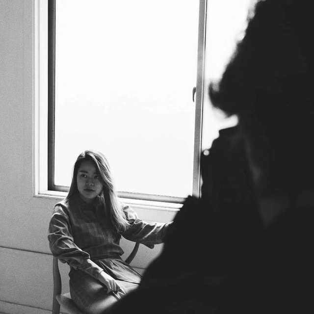 sitting-girl-light-window-black-and-white picture material