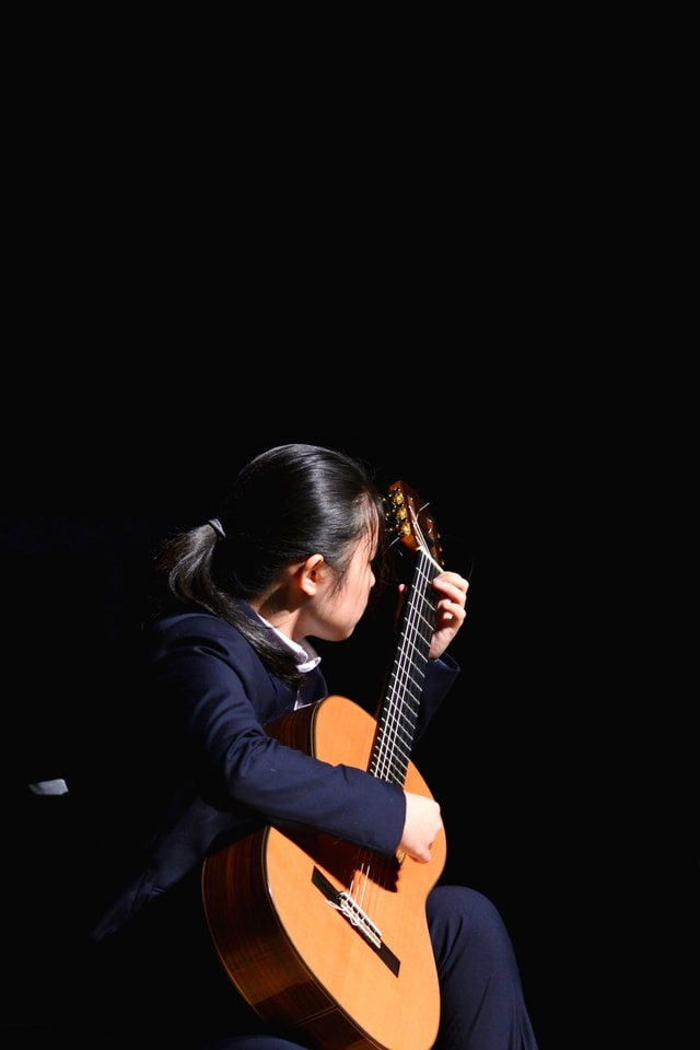 girl-playing-classical-guitar picture material