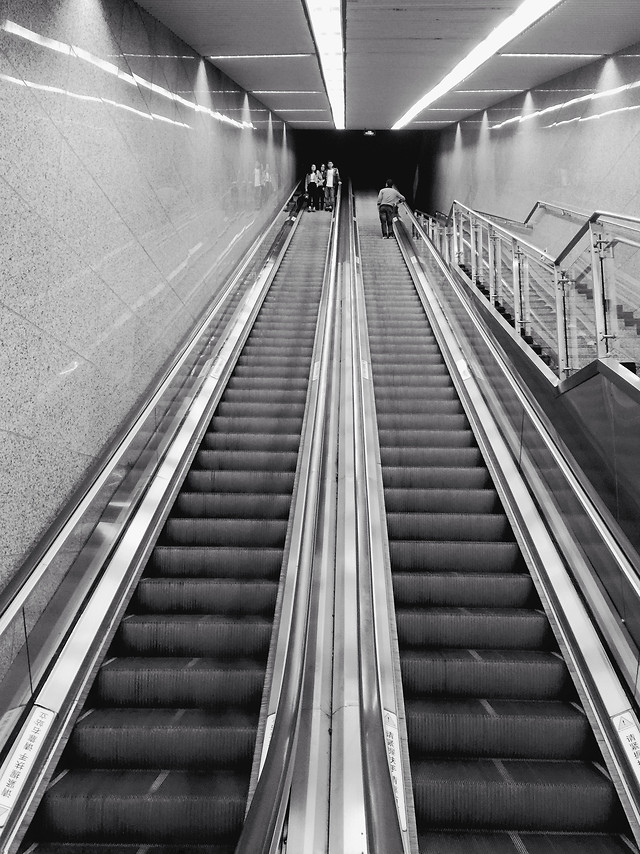 subway-system-step-escalator-airport-monochrome picture material