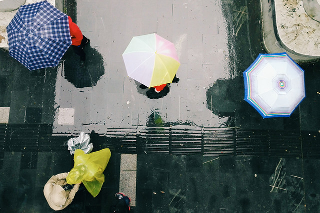 rain-umbrella-yellow-people-soccer picture material